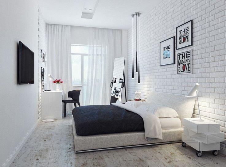 chambre adulte avec un grand lit et briques de parement en tant que dco