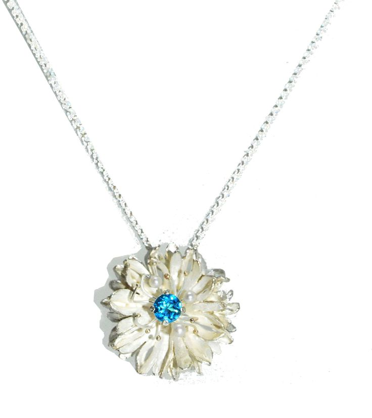 This sterling silver pendant features layers of wispy petals that create depth and delicate detail. #silver #contemporary #boutique #London  #designer #jewellery  #NudeJewellery