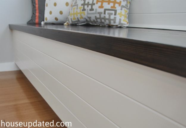 stained wood white paneled banquette bench