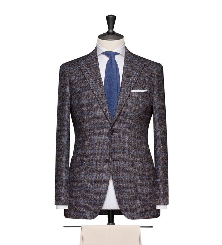 This cloth is a Brown-Blue Faux Uni with a Light Blue Windowpane. Cloth Weight: 310g Composition: 41% Alpaca, 39% Wool, 20% Polyamid