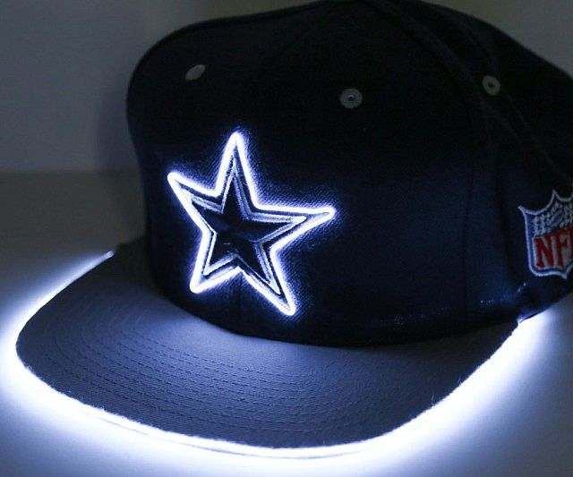 Turn heads as you show your favorite team some love by wearing a light up sports hat. These custom made hats comes in a variety of color schemes/team styles and feature bright neon trimming that outline the logo so it's visible to everyone in the room.