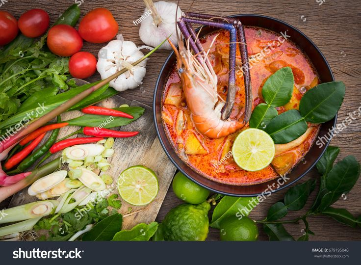Tom Yum kung Spicy Sour Soup with ingredient on wooden table top view, Thai local food
