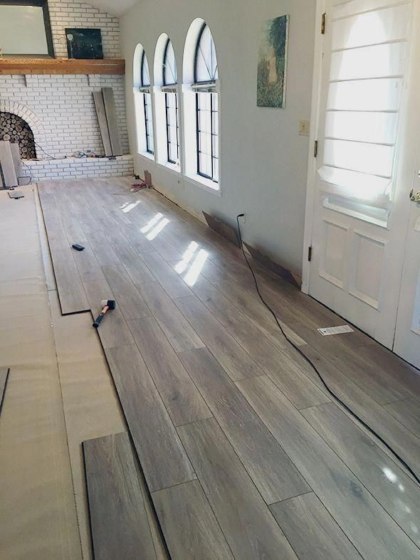 About A Month Ago My Sister And Her Husband Who Live Right Around The Corner From Us Remember This P Laminate Flooring Basement Basement Remodeling Flooring