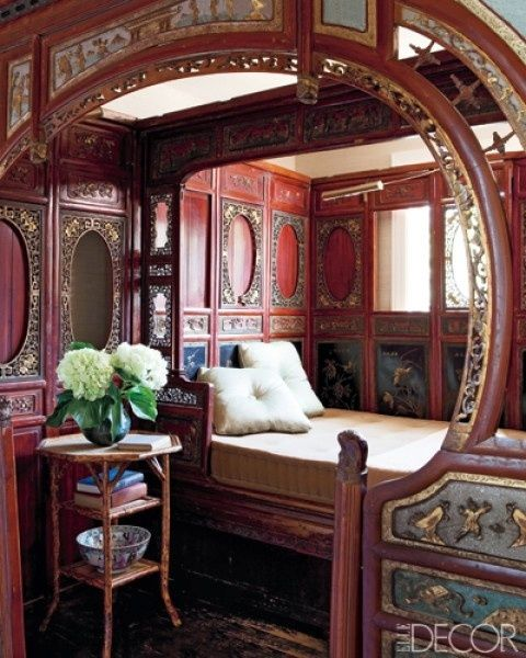 Gypsy caravan interior . The ornate woodwork with painted panels is reminiscent of an antique carousel.
