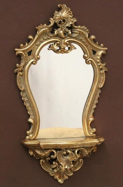 Espejo dorado barroco con ménsula  Medidas:  68x35cm  Iva incluido