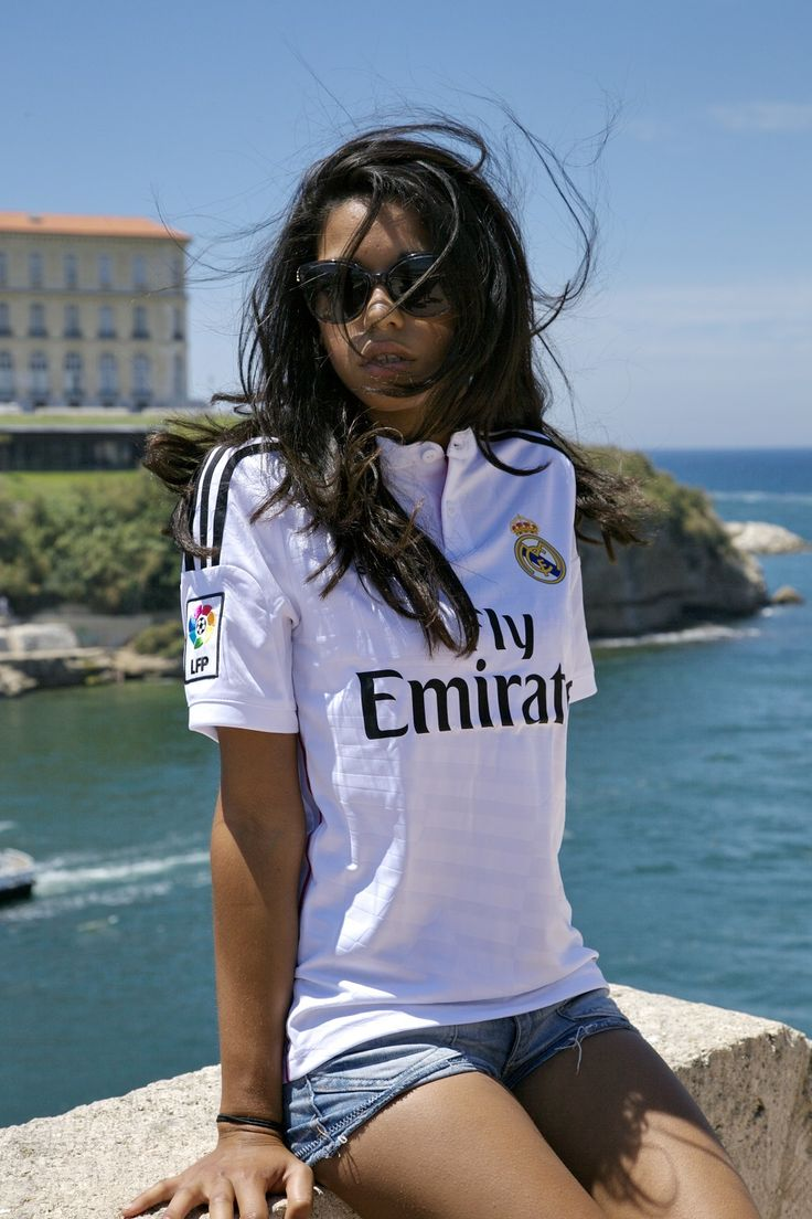 Real Madrid girl enjoying the sunshine. Southern sun. White lightening up the atmosphere.