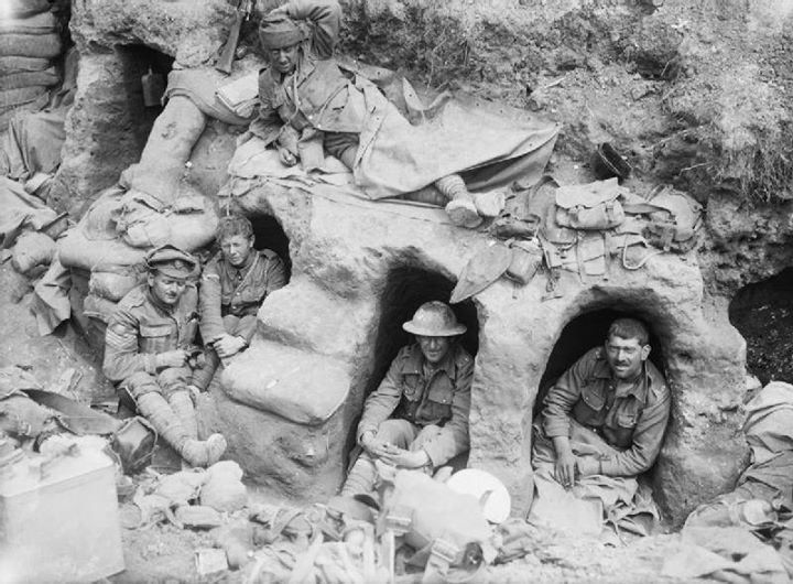 Men of the Border Regiment resting in shallow dugouts near Thiepval Wood during the Battle of the Somme 1916.