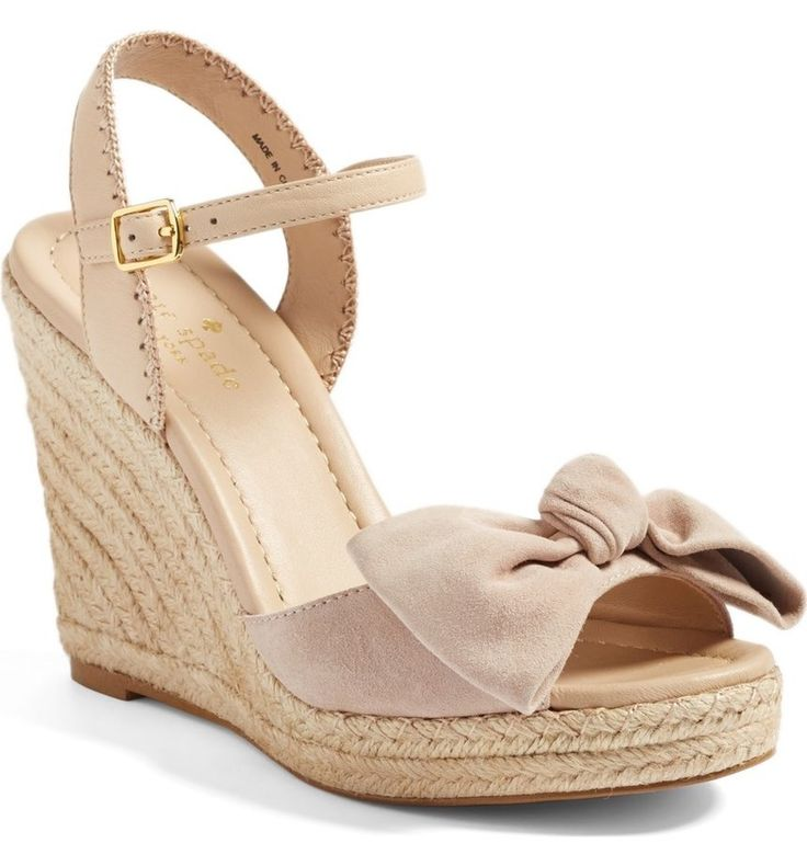 An espadrille platform wedge provides chic, summery lift, while a bow at the peep toe adds a signature Kate Spade touch.