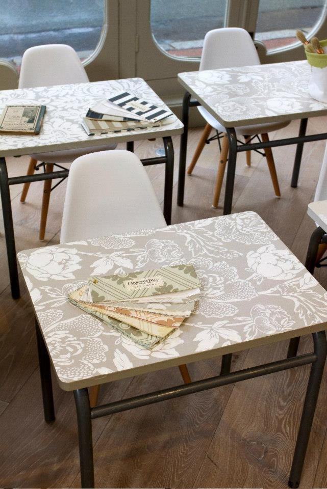 Manipulateur de Demeures, Saint Germain en Laye, France.  Table tops decorated with various Farrow & Ball wallpaper designs