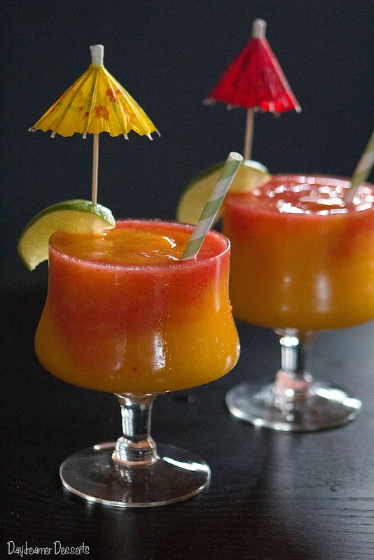 Mango Strawberry Swirl Daiquiri ~ (Mango Daiquiri: 1 large ripe mango  3 oz light rum 1 tsp sugar ½ oz lime juice Strawberry Daiquiri: 1 cup strawberries  2 oz light rum 2 tsp sugar ½ oz lime juice) #cocktail