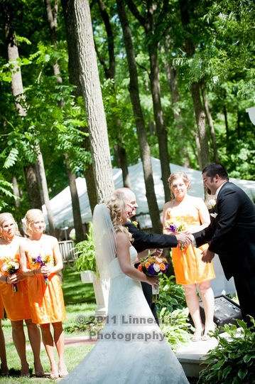 An Orange & Purple Wedding: The Father of the Bride shakes hands with the Groom as he gives away his youngest daughter. http://linnealizphotography.com