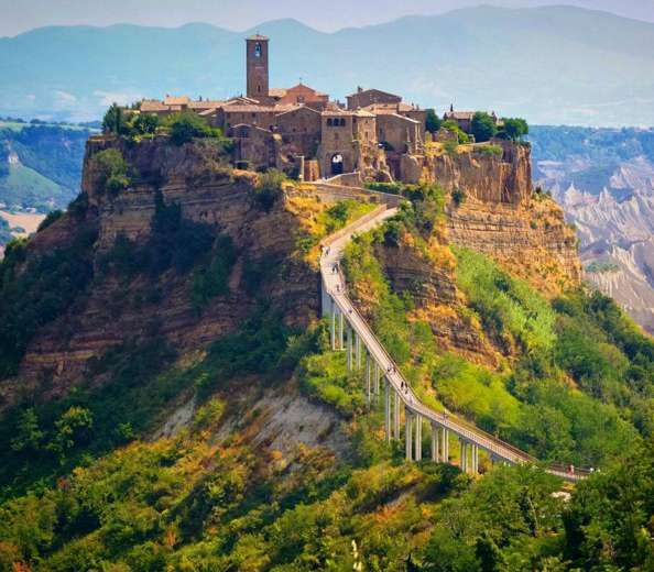 Abandoned city Civita di Bagnoregio (Italy) - Civita was erected 2500 years ago. Due to earthquakes in the 17th century, most people moved away. There is, however, still a small long bridge for the public to explore the city that is dying. - Want to discover more hidden gems in Europe? All of them can be found on www.broscene.com