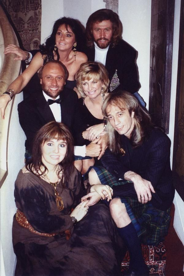 The brothers Gibb and their wives at a Hogmany party