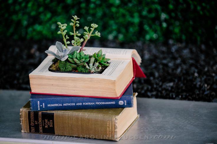 book and succulent wedding centerpiece