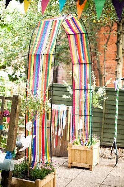 Streamers on an arch- oh how I love this! I want one for the entry to my veggie garden... or a really huge one at our front gate over the driveway!?!?!