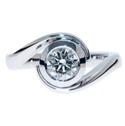 TEMPEST - WHITE GOLD SWIRLING DIAMOND ENGAGEMENT RING A free flowing swirl of white gold encaptures a majestic white brilliant cut diamond creating a pleasing visual pattern.
