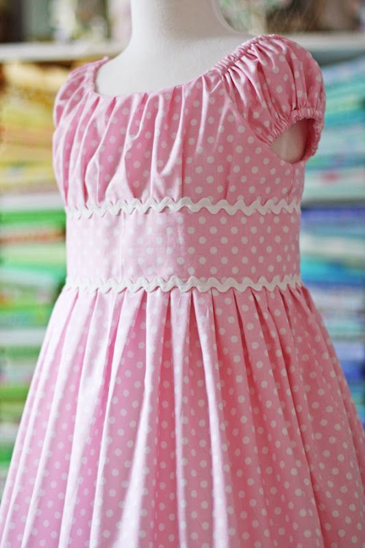 inspiration   pink and white polka dots with ric rac Olivia dress pattern by olabelhe (click on the picture to see a ton of gorgeous dresses made with the same pattern)