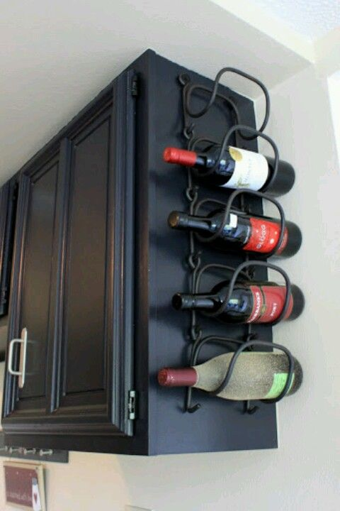 No kitchen space is wasted with a wine rack attached to the side of the cabinets