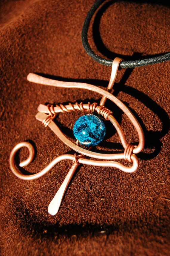 Eye of Horus Ra copper wire wrapped pendant with glass crackled blue bead