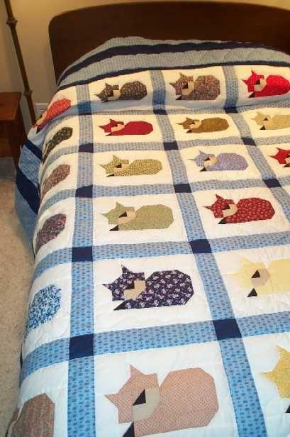 Sleeping cat quilt by Charlotte Ekker Wiggins aka bluebird gardens on etsy…