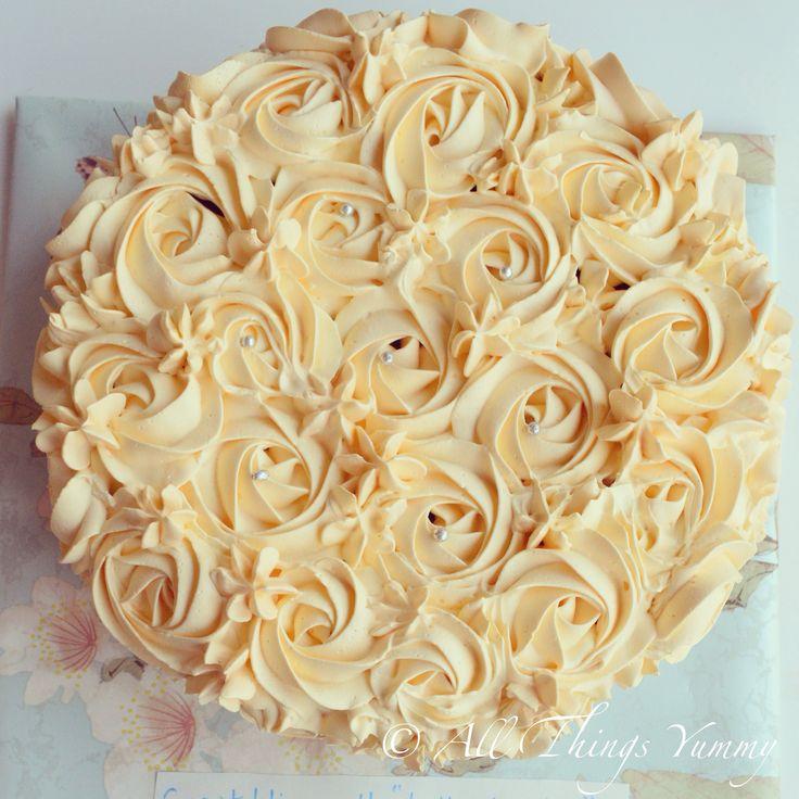 Cakes Decor Rosettes - A Champagne Gold Colored Rosettes Decor Cake | All Things Yummy #allthingsyummy #pink #rosettes #cake #icing #buttercream #rosettes #whippedcream #cake #atyummy #flowers #piping #stars #champagnecolor #dullgold #anniversarycake #chocolatecake #customisedcake #nofondant #yummy