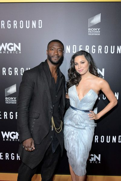 "Aldis Hodge Photos Photos - Actors Aldis Hodge (L) and Jurnee Smollett-Bell attend WGN America's ""Underground"" Season Two Premiere Screening at Regency Village Theatre on March 1, 2017 in Westwood, California. - WGN America's ""Underground"" Season Two Premiere Screening"