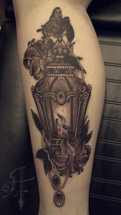 Grey Butterfly With Antique Lantern Tattoo On Leg