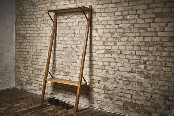 The idea behind the Tilt hallstand was to create a piece of hall furniture, which would fit in a small and narrow hallway without any need for mounting in the wall.  The Tilt hallstand allows both the access to hang up one's clothes and sit to take shoes on and off.              www.DesignbySortkjaer.com