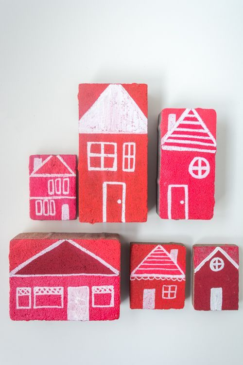 Painted bricks for outdoor pretend play. This is a fun DIY project for kids and after, they can use the bricks to build a pretend city or village.