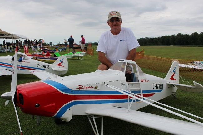 Karl Gross, of Burlington, poses with his model Hanger 9 Piper -- complete with a pilot modeled on himself -- at the annual Bluewater R/C Flyers'…