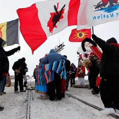 "Aboriginal protestors block a CN railroad track near Portage La Prairie, Man., in January. An Ontario judge has recommended that police ""lay criminal charges against the six demonstrators who have prevented access to the [De Beers] mine site"" south of Ontario's Attawapiskat reserve @go4david/cbc"