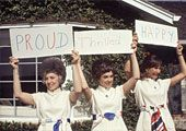 How do they score?! Astrowives Sue Bean, Barbara Gordon, and Jane Conrad hold up the club's motto during Apollo 12, November 1969.