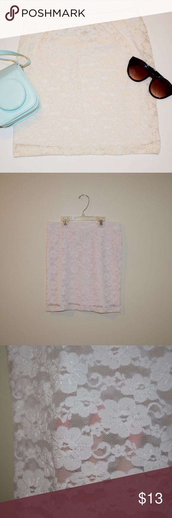 Forever 21 Mini Skirt NWOT White lace mini skirt: one lace layer and one thick white layer that fits to body. Stretchy material. NWOT!  **Extra items pictured in first photo are not included. Forever 21 Skirts Mini
