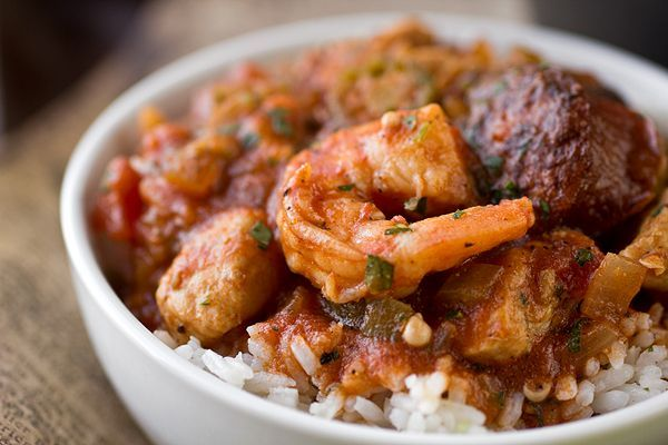 """Full of zesty flavors, this """"Gumbo-laya"""" Stew is the best of gumbo and jambalaya in one with spicy sausage, chicken, shrimp and okra over garlic rice"""