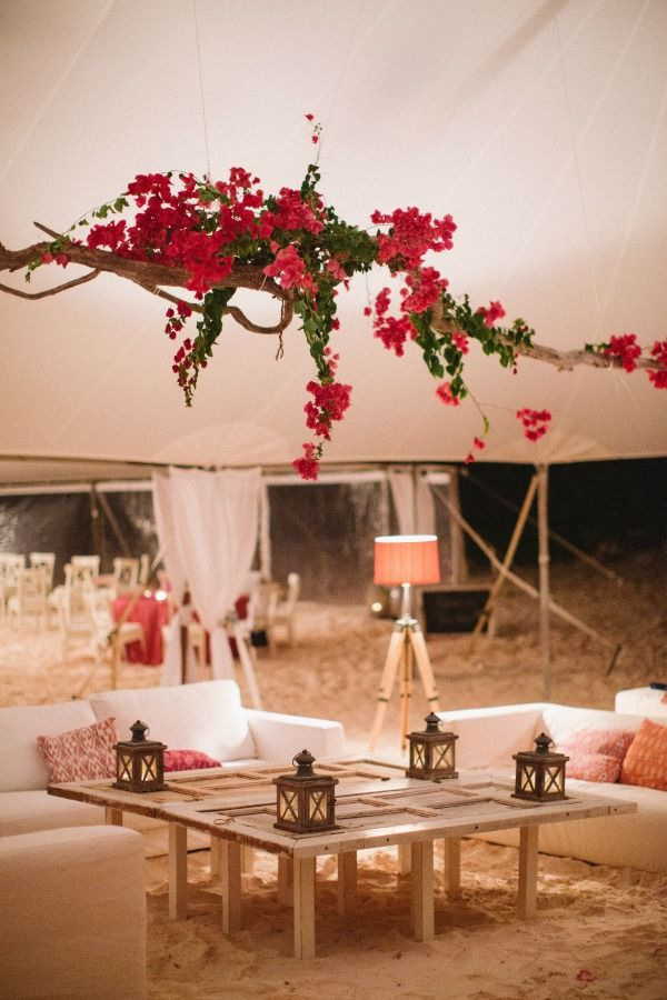 Gorgeous hanging centerpiece covered with bougainvillea | Bahamas Beach Rehearsal Dinner | Jenelle Kappe Photography