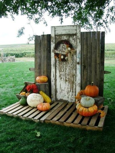 Jerri Clark's back drop of door and pallets Use pallets for a floor in a garden scene.
