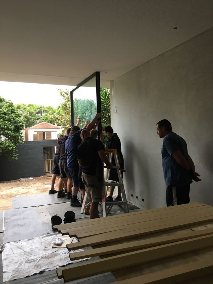 Queens Park - Installation of Pivot Doors. Takes many men!