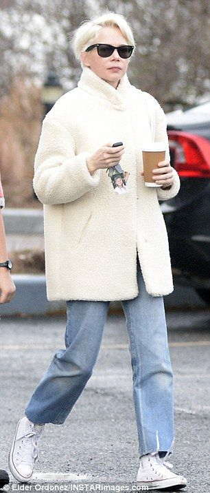 Platinum blonde: The 36-year-old actress paired her winter-white outerwear with baggy blue jeans, white Converse high-tops, and classic Ray-Bans