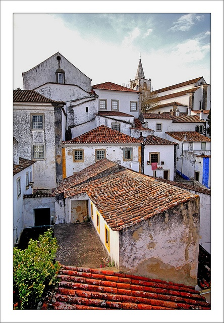Traditional Spanish clay tiles roofs.