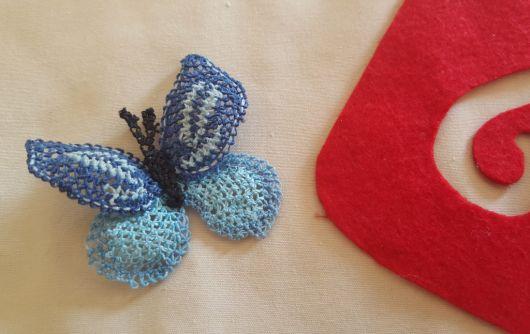 igne-oyasindan-mavi-kelebek