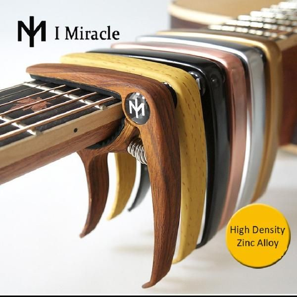 I Miracle Guitar Capo With Bridge Pin Remover For Acoustic And Electric Guitars Regular Price 19 90 Usd Guitar Capo Acoustic Guitar Semi Acoustic Guitar