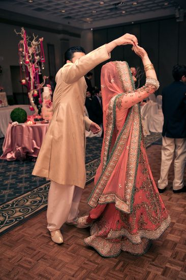 Bride and  Groom Dancing....love the color of her dress!!!