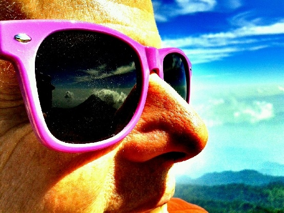 Volcan de Colima, Nevado's hyper-active brother volcano, is reflected in my sunglasses on the summit of Nevado de Colima. Thanks to Jupiter, our guide, for this arty photograph!