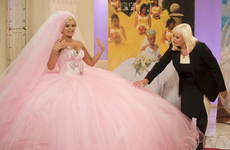 Psychotically huge Gypsy wedding dresses... These broads can't even fit through a door for crying out loud!