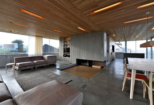 Floating house. Recessed lighting and fireplace. Sunlit unobstructed views.