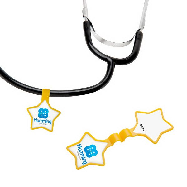 Star Stethoscope ID Tag ST77 - Include this unique identification tag during corporate events, career fairs, or academic-themed promotions. With a large decorating area on the star, no stethoscope should be without one! This item features a one piece, clamshell design that snaps together. It can be personalized, by hand, on the back side label. This promo item is an excellent choice for medical school, pediatricians' offices and hospitals. #propelpromo
