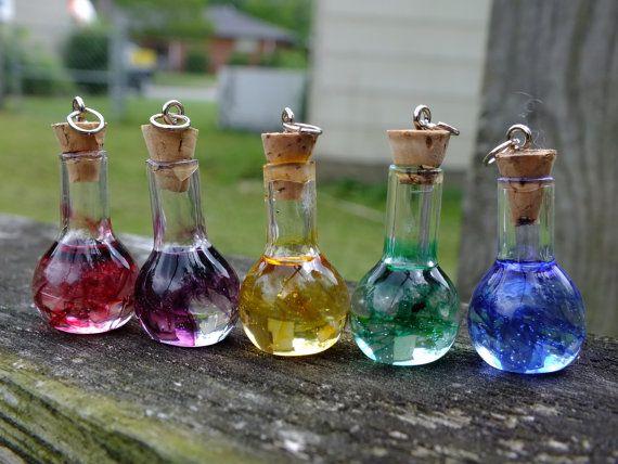 Set of 5 Miniature Glass Potion Bottles, Color Cascading Effect Charm Pendants/Ornaments. $32.00, via Etsy.