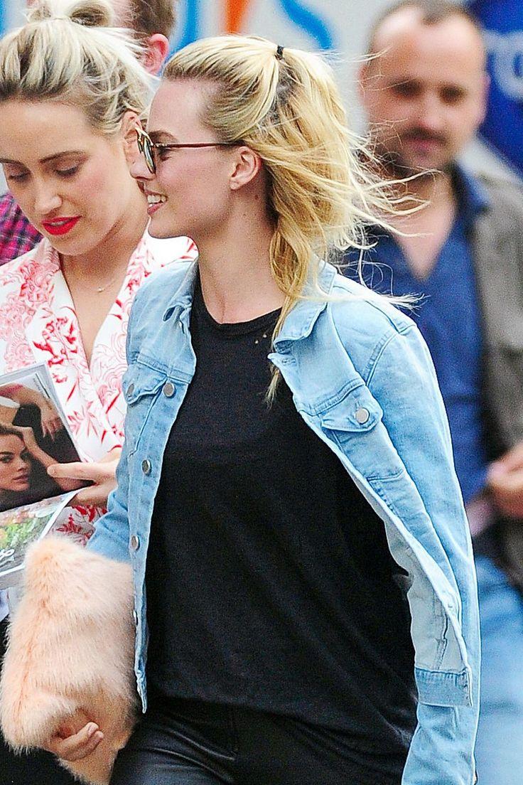 Margot Robbie gives her blonde hair an easy half-up half-down update.