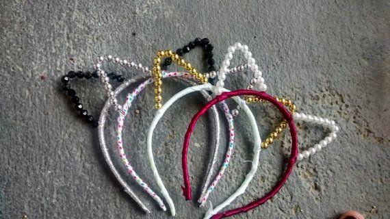 Taylor Swift inspired pearl and ribbon cat ear headband    https://www.etsy.com/listing/226943995/ribbon-and-pearl-cat-ear-headband