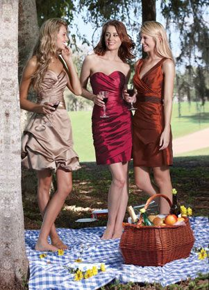 Dress on the left in Orange... Gotta get my tan on so my dress dont out shine me
